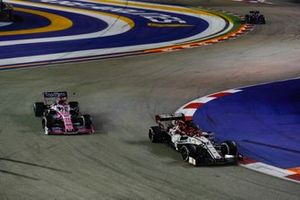 Kimi Raikkonen, Alfa Romeo Racing C38, leads Sergio Perez, Racing Point RP19