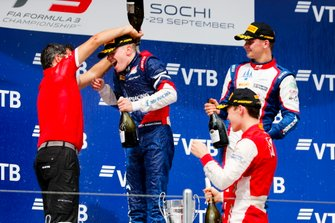 Robert Shwartzman, PREMA Racing, Marcus Armstrong, PREMA Racing and Niko Kari, Trident on the podium with the champagne