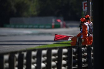 Marshals wave a red flag