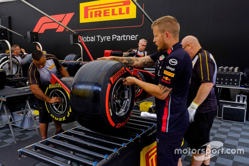 Pirelli and Red Bull Racing member at work
