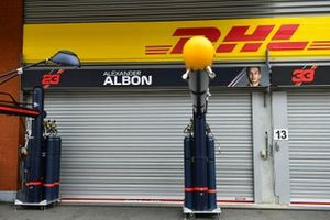 A sign for Alex Albon, Red Bull Honda, in the pit lane