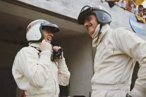 Jackie Stewart and Graham Hill, laugh in the pits