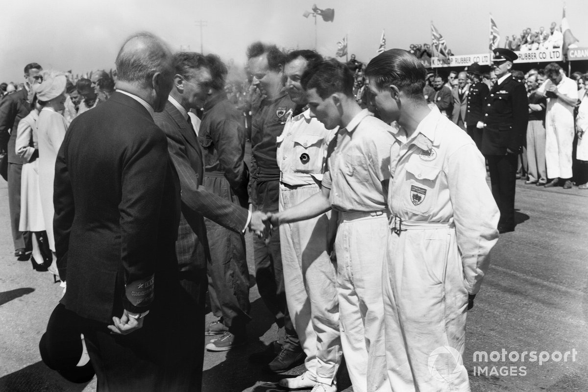 King George VI meets the drivers, including a young Stirling Moss