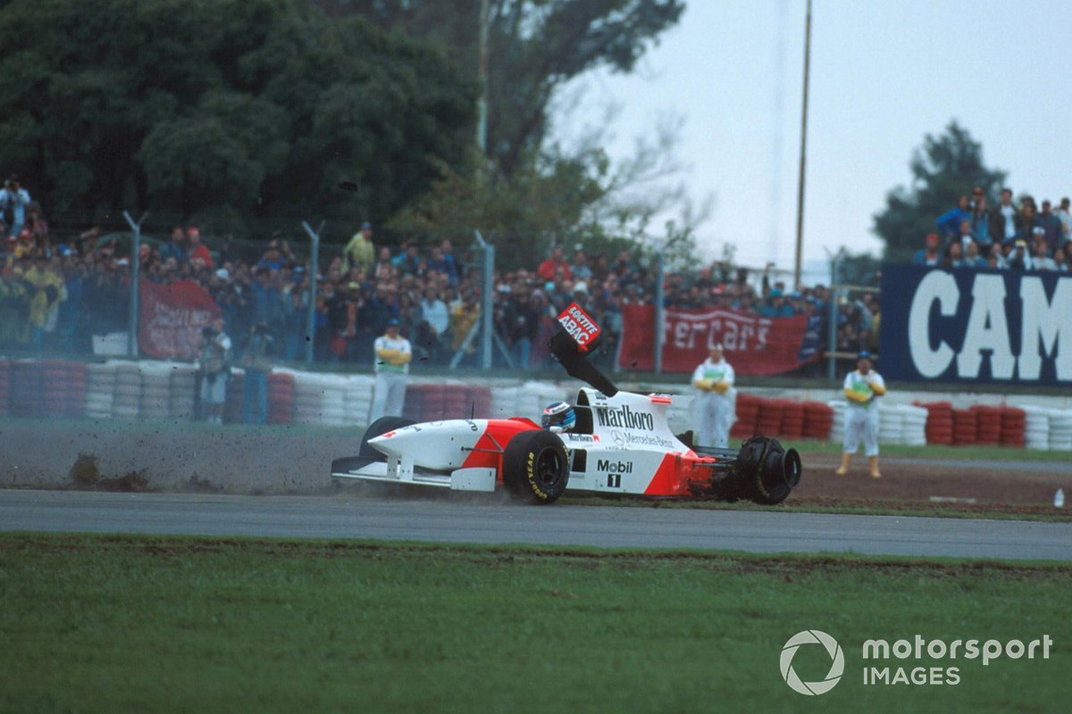 Mika Hakkinen, Mclaren MP4-10 spins off after collision with Eddie Irvine