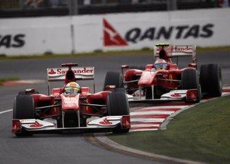 Felipe Massa, Ferrari F10, leads Fernando Alonso, Ferrari F10
