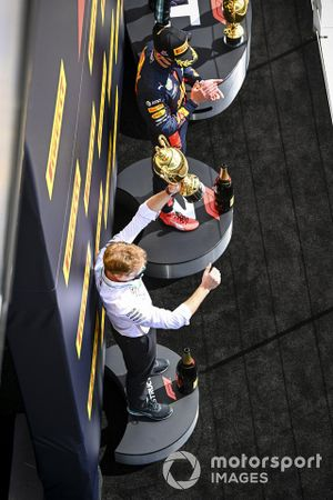 The Mercedes Constructors trophy delegate lifts the Constructors trophy