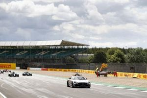 The Safety Car the field past the crash scene of Kevin Magnussen, Haas VF-20