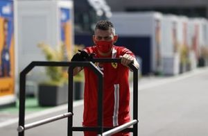 A member of the Ferrari team in the paddock