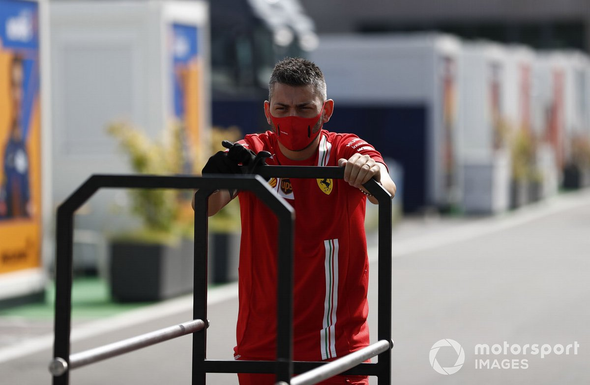 A member of the Ferrari team in the paddock