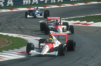 Ayrton Senna, McLaren MP4/5B Honda leads Gerhard Berger, McLaren MP4/5B Honda and Jean Alesi. Tyrrell 019 Ford