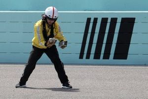 Track safety worker picks up debris during the race