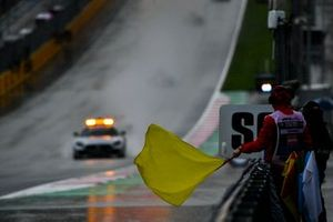Marshal waves the yellow flag Alexander Smolvar, ART Grand Prix the Safety Car passes