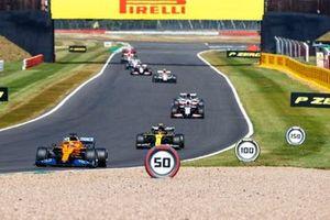 Carlos Sainz Jr., McLaren MCL35, Esteban Ocon, Renault F1 Team R.S.20 and Kevin Magnussen, Haas VF-20