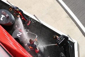 Max Verstappen, Red Bull Racing, celebrates on the podium by spraying champagne alongside Lewis Hamilton, Mercedes AMG F1