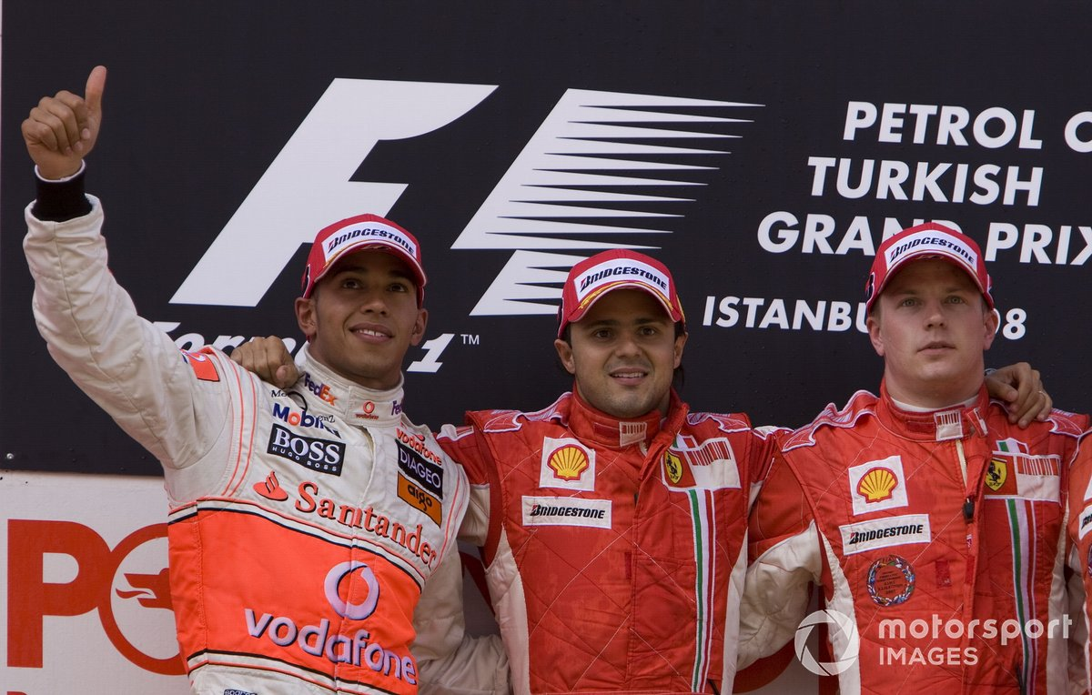Lewis Hamilton, McLaren MP4-23 Mercedes, 2nd position, Felipe Massa, Ferrari F2008, 1st position, and Kimi Raikkonen, Ferrari F2008, 3rd position, on the podium
