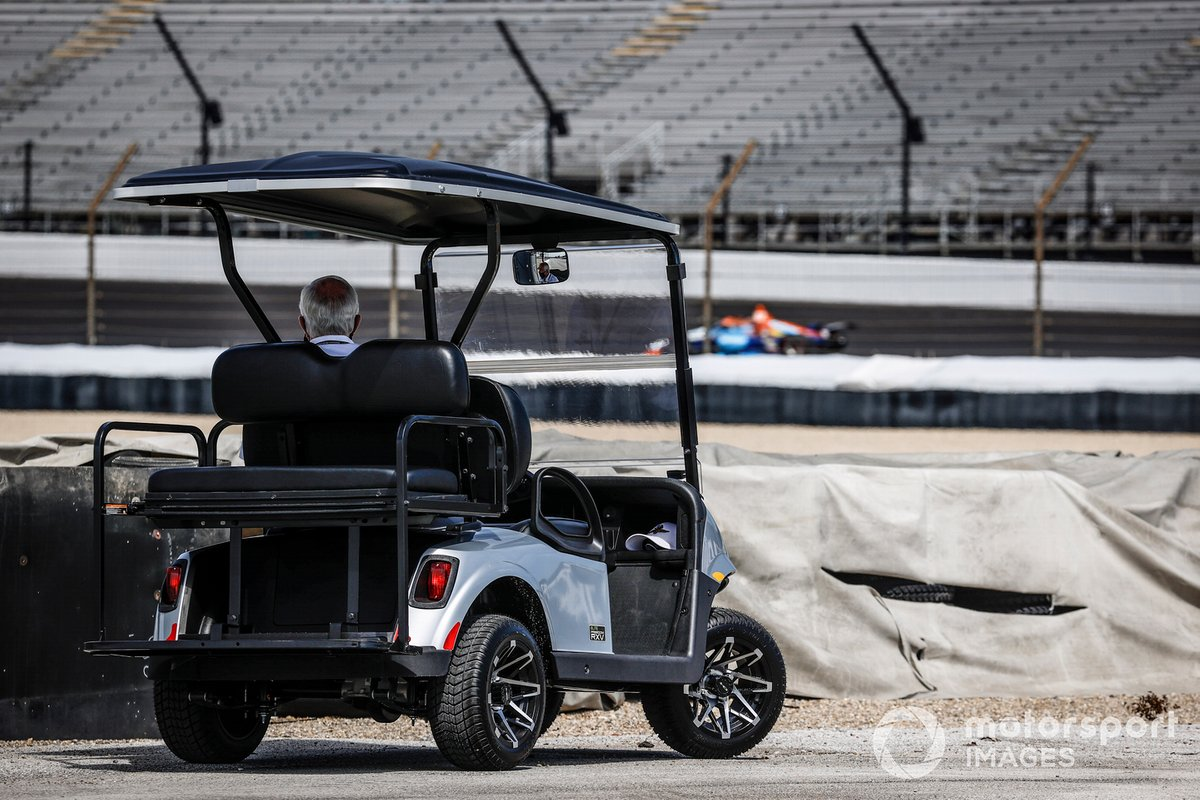 Roger Penske watches practice from turn 4