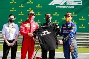 Mercedes F1 Team Member, Charles Leclerc, Ferrari, Race winner Valtteri Bottas, Mercedes-AMG Petronas F1 and Lando Norris, McLaren pose with a End Racism TShirt on the podium