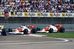 Alain Prost, McLaren MP4-2 TAG, leads Niki Lauda, McLaren MP4-2 TAG