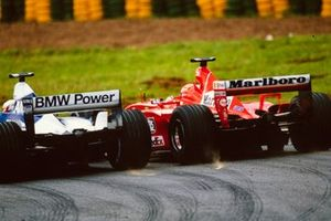 Michael Schumacher, Ferrari F2001, battles with Juan Pablo Montoya, Williams FW23 BMW