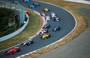 Eddie Irvine, Ferrari F399 leads the pack