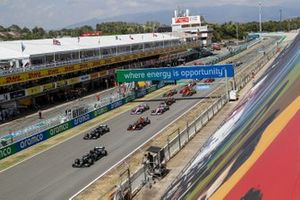 Lewis Hamilton, Mercedes F1 W11 EQ Performance leads Valtteri Bottas, Mercedes F1 W11 EQ Performance and Max Verstappen, Red Bull Racing RB16 at the start of the race