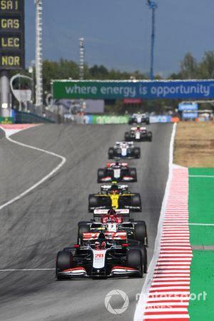 Kevin Magnussen, Haas VF-20, leads Kimi Raikkonen, Alfa Romeo Racing C39, Esteban Ocon, Renault F1 Team R.S.20, and Romain Grosjean, Haas VF-20