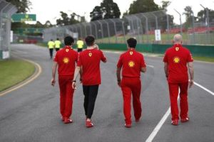 Charles Leclerc, Ferrari walks the track with members of the team including Jock Clear, Race Engineer, Ferrari