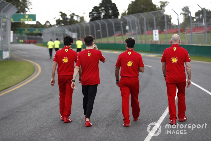 Charles Leclerc, Ferrari walks the track with members of the team including Jock Clear, Race Engineer, Ferrari