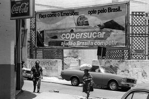 An advertising hoarding in Sao Paulo showing the locals that Emerson Fittipaldi, had moved from McLaren to the Copersucar-Fittipaldi team