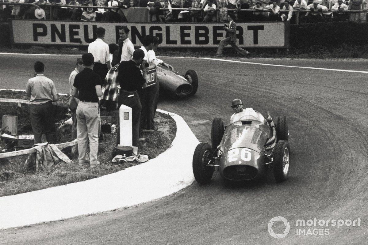 Juan Manuel Fangio, Maserati 250F, leads Mike Hawthorn, Ferrari 625