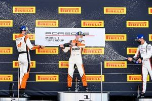 Max van Splunteren, Team GP Elite, Larry ten Voorde, Team GP Elite, and Jaxon Evans, BWT Lechner Racing, celebrate with Champagne on the podium