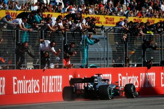 Lewis Hamilton, Mercedes AMG F1 W10, is greeted by his team at the finish