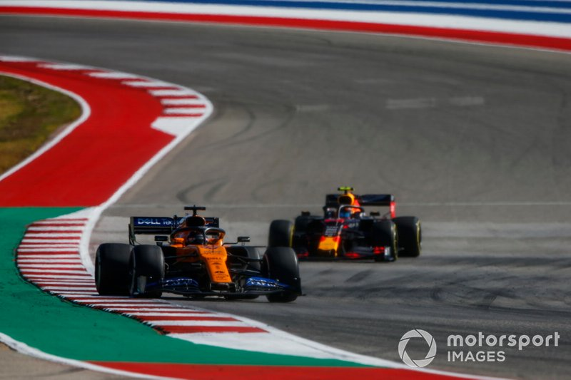 Carlos Sainz Jr., McLaren MCL34, leads Alex Albon, Red Bull Racing RB15