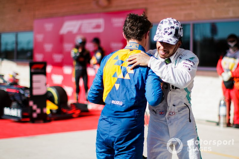 Lando Norris, McLaren, congratulates Lewis Hamilton, Mercedes AMG F1, 2nd position, on securing his sixth world title