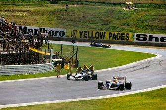 Nigel Mansell, Williams FW14B Renault, passes marshals recovering Giovanna Amati, Brabham BT60B