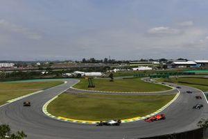 Max Verstappen, Red Bull Racing RB15, leads Lewis Hamilton, Mercedes AMG F1 W10, and Sebastian Vettel, Ferrari SF90
