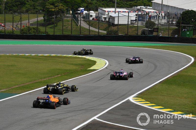 Sergio Perez, Racing Point RP19, leads Nico Hulkenberg, Renault F1 Team R.S. 19, and Carlos Sainz Jr., McLaren MCL34