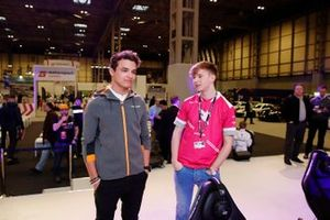 Lando Norris, McLaren with Tobin Leigh on the Le Mans eSports Series stand