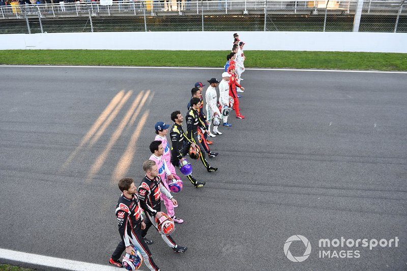 The drivers walk along the track