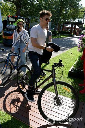 Charles Leclerc, Ferrari rides his bike in the circut with his girlfriend Charlotte Sine