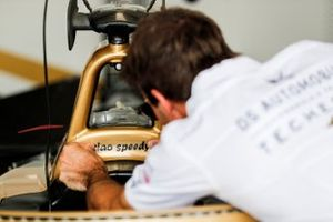 Antonio Felix da Costa, DS Techeetah, applies a 'Ciao Speedy' sticker to his car in memory of motorcyclist Paulo Goncalves, who tragically died after an accident at the Dakar Rally 2020
