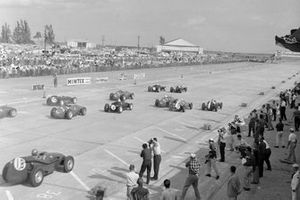 Jack Brabham, Cooper T51 Climax, leads Stirling Moss, Cooper T51 Climax