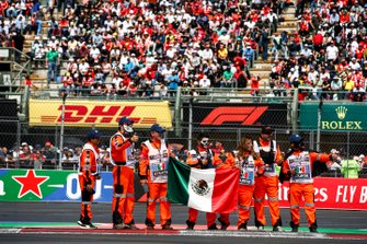 Marshals with Mexican flag on the drivers parade