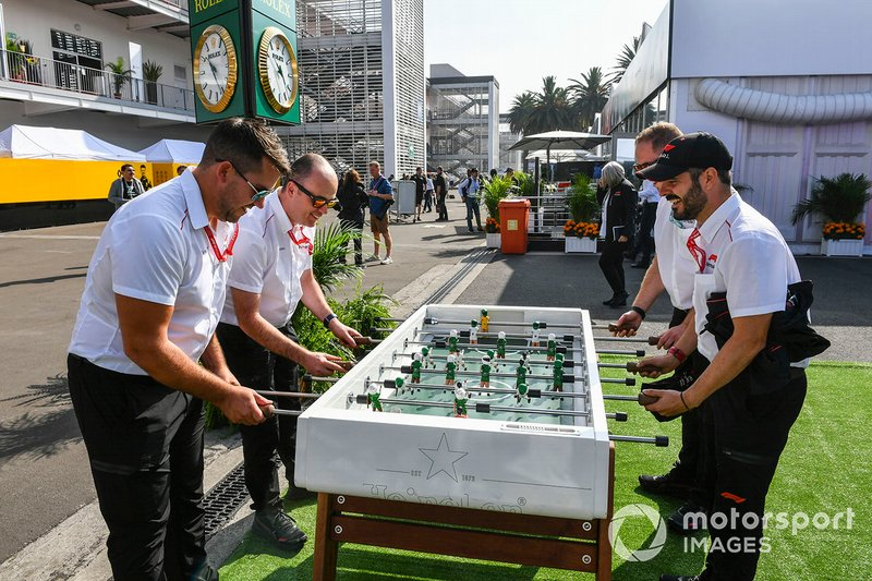 F1 personnel play table football in the paddock