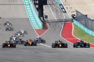 Lewis Hamilton, Mercedes W12, battles with Max Verstappen, Red Bull Racing RB16B, ahead of Sergio Perez, Red Bull Racing RB16B, Daniel Ricciardo, McLaren MCL35M, and the rest of the field at the start
