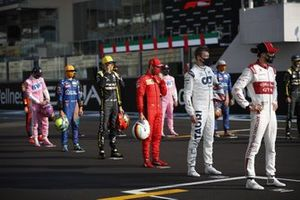 Antonio Giovinazzi, Alfa Romeo, Daniil Kvyat, AlphaTauri, Sebastian Vettel, Ferrari, Esteban Ocon, Renault F1, and Lando Norris, McLaren on the grid for the end of season photo