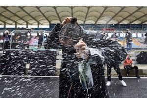 Lewis Hamilton, Mercedes-AMG F1, is sprayed with champagne after winning his 7th World Championship