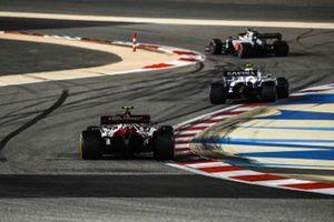 Kevin Magnussen, Haas VF-20, Nicholas Latifi, Williams FW43, and Antonio Giovinazzi, Alfa Romeo Racing C39