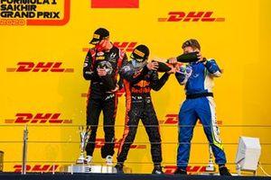 Nikita Mazepin, Hitech Grand Prix, 3rd position, and Yuki Tsunoda, Carlin, 1st position, spray champagne on the podium