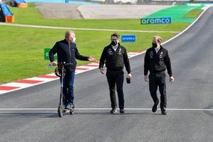 Johnny Herbert, Sky TV walks the track on a scooter with Andrew Shovlin, Chief Race Engineer, Mercedes AMG